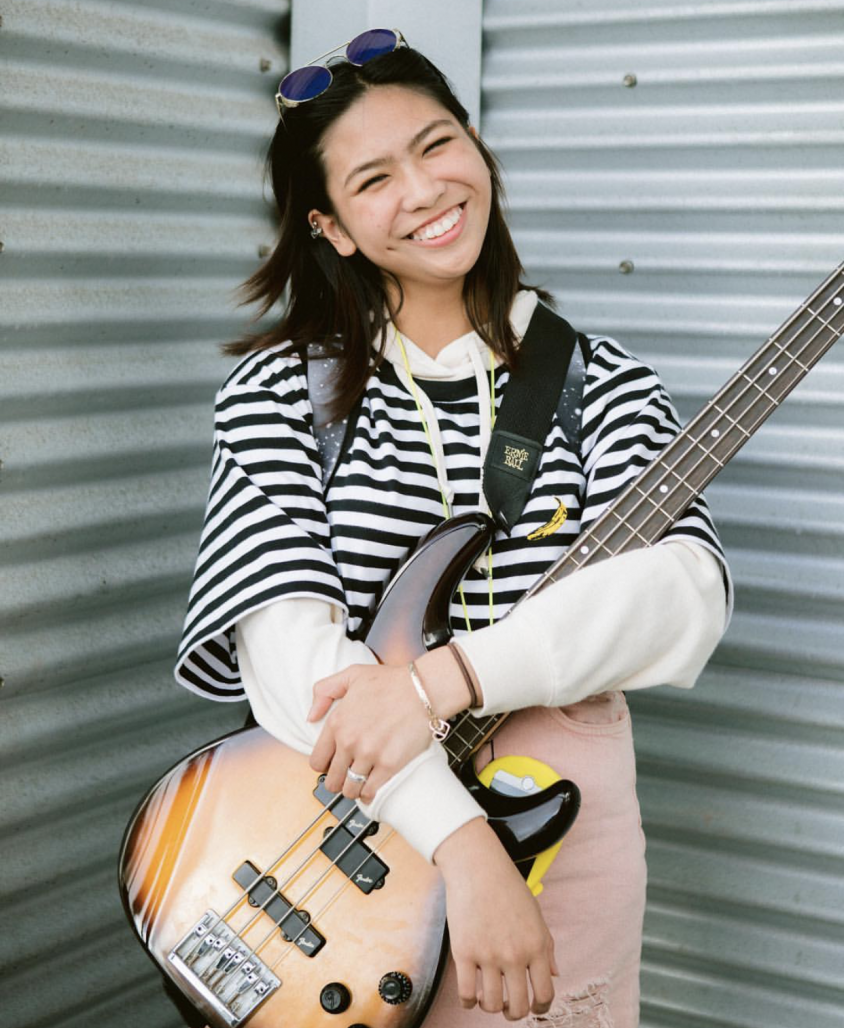 Manamtam poses with her guitar.