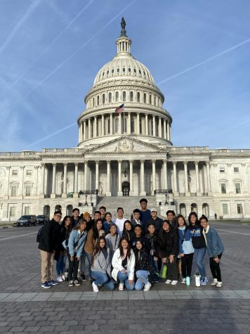 MeneMAC's STN team smiles in front of the Capitol in Washington, D.C.